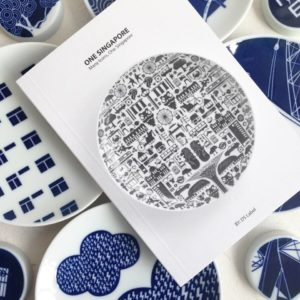 "Accompanying DS Label's newest porcelain plate, ""One Singapore,"" is this booklet consisting of archival images from the National Archives of Singapore. The book is not for sale because of copyright restrictions but can be obtained when customers order the plate. 