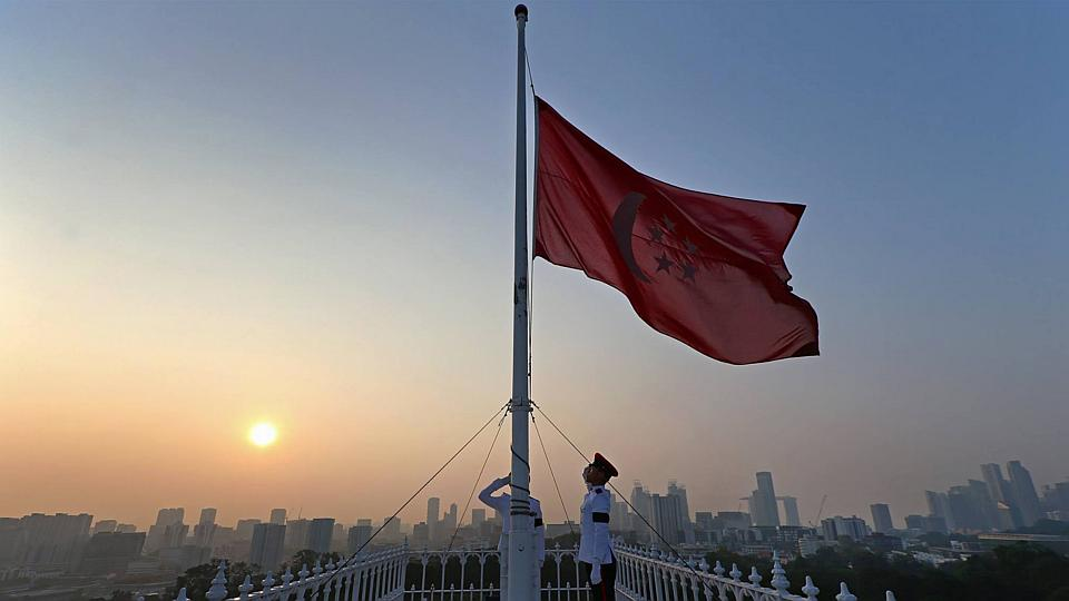 A flag at half-mast at the Istana on March 23, 2015. BY MINISTRY OF COMMUNICATIONS AND INFORMATION / TERENCE TAN